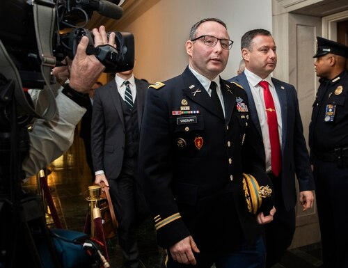 National Security Council aide Lt. Col. Alexander Vindman, left, leaves Capitol Hill as they conclude a public impeachment hearing of President Donald Trump in Washington on Nov. 19, 2019. (Manuel Balce Ceneta/AP)