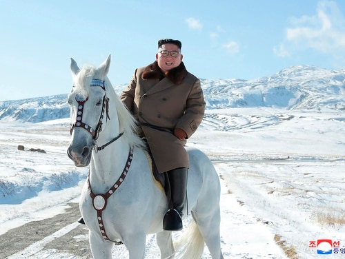 In this undated photo provided on Wednesday, Oct. 16, 2019, by the North Korean government, North Korean leader Kim Jong Un rides a white horse to climb Mount Paektu, North Korea. (Korean Central News Agency/Korea News Service via AP)