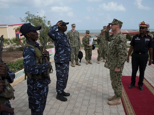 Rear Adm. Shawn E. Duane, vice commander of 6th Fleet, receives a salute from a member of the Djiboutian Coast Guard during the opening ceremony of the Cutlass Express 2018 exercise on Jan. 31 in Djibouti, Djibouti. Senators on Tuesday discussed why the U.S. Africa Command is not based in Africa. (Staff Sgt. Allyson Manners/Air National Guard)