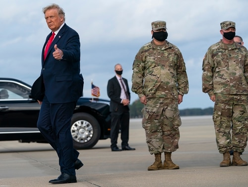 President Donald Trump gives a thumbs up after arriving at Pope Army Field for an event with troops at Fort Bragg, N.C., Oct. 29, 2020. (Evan Vucci/AP)
