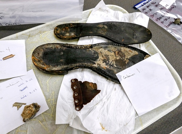 In this Sept. 18, 2018, photo, various items including shoe soles, a watch and a partial ID tag are processed at the Defense POW/MIA Accounting Agency (DPAA) Identification laboratory at Offutt Air Force Base in Bellevue, Neb. The various artifacts found with the remains of unidentified service members are used in the identification process. (Nati Harnik/AP)