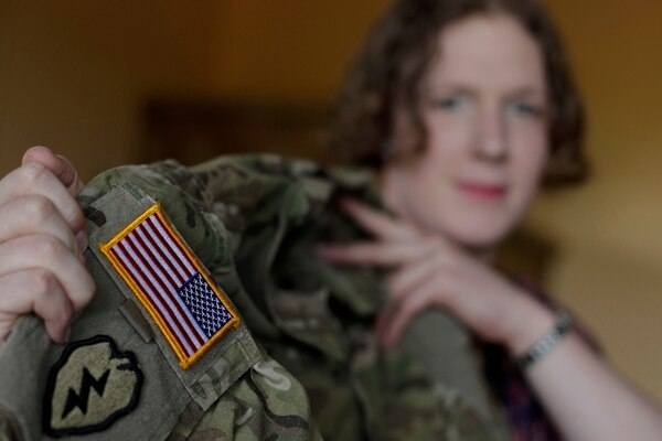 In this July 29, 2017, photo, transgender U.S. Army Capt. Jennifer Sims lifts her uniform during an interview with The Associated Press in Beratzhausen, near Regensburg, Germany. (Matthias Schrader/AP)