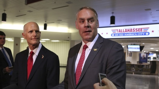 A new report out of the Department of Interior Office of Inspector General found that Secretary Ryan Zinke (right) had violated agency travel policies. (Scott Keeler/Tampa Bay Times via AP)