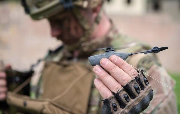 The tiny drone, used by U.K. forces abroad since 2011, was retired from service in 2017. A new order suggests the Black Hornet is about to be reintroduced into the British Army. (Daniel Wiepen/British Ministry of Defence)