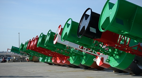 Recently painted aids to navigation buoys stand ready to be deployed as channel markers in the Coast Guard buoy yard in 2017 at Naval Station Newport in Newport, R.I. (Petty Officer 3rd Class Nicole J. Groll/U.S. Coast Guard)