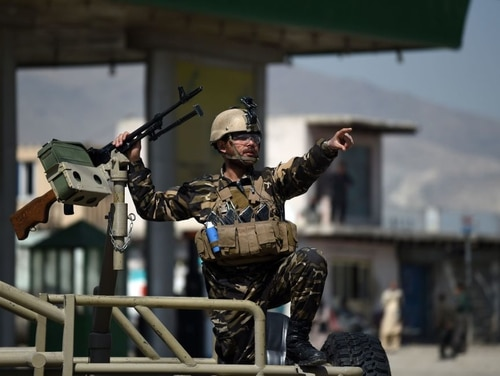A member of the Afghan security forces secures the site of a car bomb attack in Kabul on March 17, 2018. An inspector general report released May 21, 2018, by the Pentagon said there are few signs of significant progress by Afghan forces. (Wakil Kohsar/AFP via Getty Images)