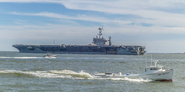 The aircraft carrier Harry S. Truman sails across the Chesapeake Bay, heading for open seas for the first time in three months. (Mark D. Faram/Staff)