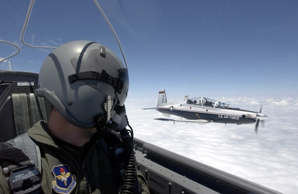 A T-6 Texan pilot flies in formation with another T-6 over Laughlin Air Force Base in Texas. The 19th Air Force's fleet of T-6 trainers have been grounded since Feb. 1. (Tech. Sgt. Jeffrey Allen/Air Force)