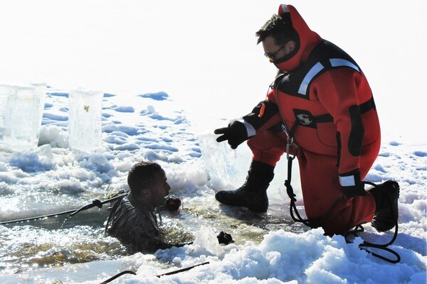 A Marine at Fort McCoy for the 2nd Marine Air Wing's Ullr Shield exercise participates in cold-water immersion training at Big Sandy Lake on South Post on Jan. 17, 2018, at Fort McCoy, Wis. (Scott T. Sturkol/Army)