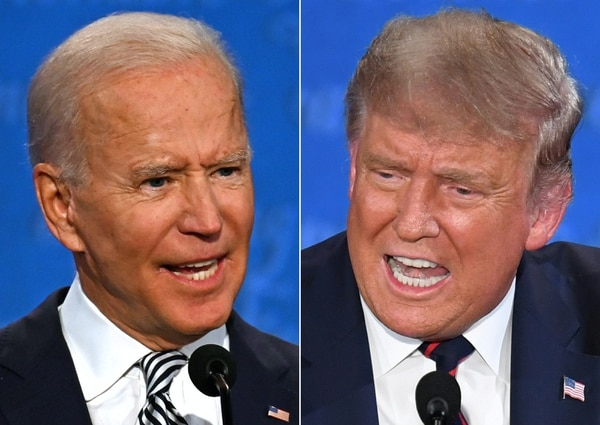 Democratic presidential candidate and former U.S. Vice President Joe Biden, left, and U.S. President Donald Trump speak during the first presidential debate at the Case Western Reserve University and Cleveland Clinic in Cleveland, Ohio, on Sept. 29, 2020. (Jim Watson and Saul Loeb/AFP via Getty Images)