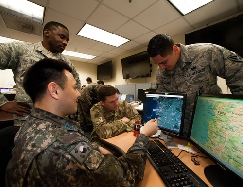 Members of the 607th Security Forces Squadron use Google Maps to identify force protection threats during Key Resolve 16 at Osan Air Base, Republic of Korea, March 10, 2016. The section also uses GeoBase, which is a collection of satellite images, computers and digital software that can electronically send maps and environmental information to a user's fingertips. (U.S. Air Force photo by Staff Sgt. Nick Wilson/Released)