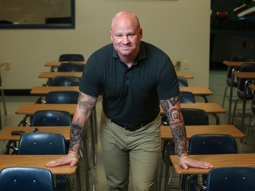 Seen in an Aug. 3, 2017, photo, Jeff Shelton, who spent over 20 years serving in the armed forces, retiring as a major from the U.S. Air Force, is preparing to start his second year teaching at Lamar Consolidated High School in Rosenberg, Thursday, July 3, 2017. Shelton is among more than 3,000 veterans in Texas who traded bulletproof vests for textbooks to become teachers supported by the Troops to Teachers program. (Mark Mulligan/Houston Chronicle via AP)