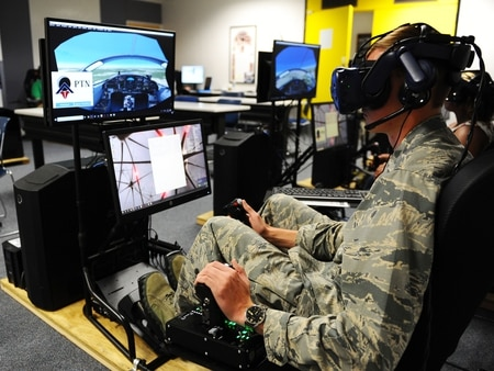 Cadet 1st Class Cade Cavanagh uses a virtual reality system to practice flying skills at the Air Force Academy. The school launched a VR pilot training program called Airmanship Next. (Jennifer Spradlin/Air Force Academy)