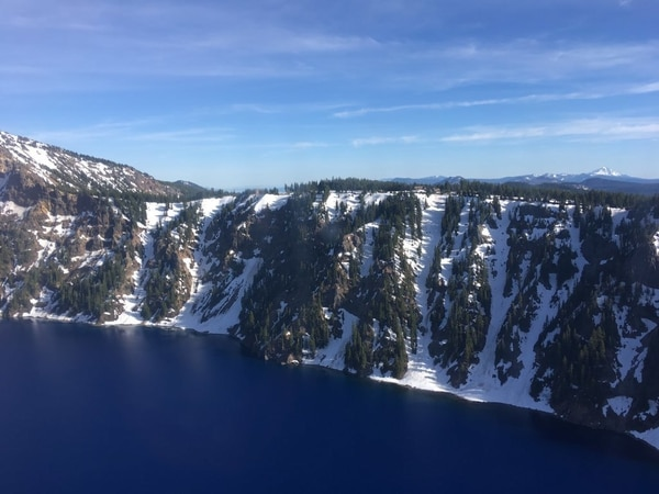 Aerial view of the caldera of Crater Lake National Park near Rim Village Crater Lake National Park, Ore., on June 10, 2019. (Petty Officer 1st Class Levi Read/Coast Guard)