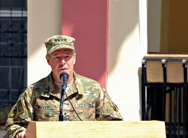 Army Gen. Scott Miller, commander of U.S. and NATO troops in Afghanistan, speaks during the Resolute Support mission change of command ceremony in Kabul, Afghanistan on Sept. 2, 2018. Afghan officials said Thursday, Oct. 18, 2018 that three top Kandahar province officials have been killed by their own guards in an attack at a security meeting that also wounded two U.S. troops. A Taliban spokesman who claimed responsibility for the attack told The Associated Press that Miller was the target. He escaped unharmed. (Tech. Sgt. Sharida Jackson via AP)