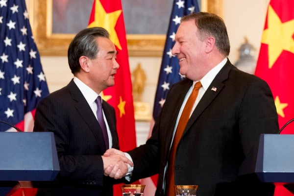 Secretary of State Mike Pompeo and Chinese State Councilor and Foreign Minister Wang Yi shake hands following a news conference at the State Department, Wednesday, May 23, 2018, in Washington. (Andrew Harnik/AP)