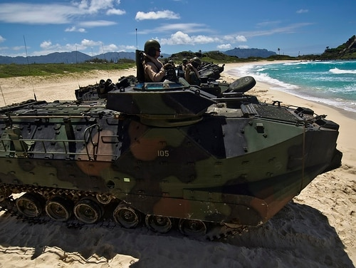 Marines assigned to Combat Assault Company, 3rd Marine Regiment, Marine Corps Base Hawaii-Kane'ohe Bay stand by in R7-A1 amphibious assault vehicles off Pyramid beach July 12, 2012. (Tech. Sgt. Michael Holzworth)