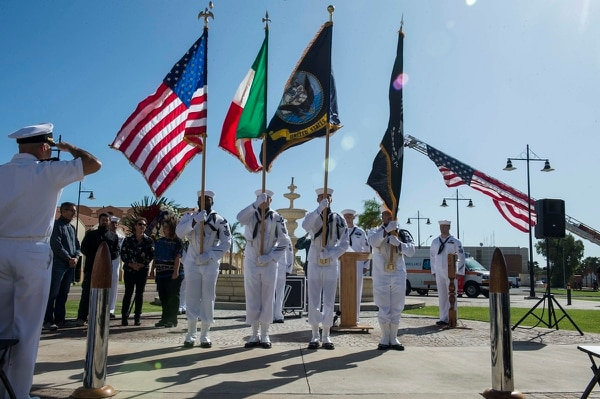 Capt. Brent Trickel, commanding officer of Naval Air Station (NAS) Sigonella, salutes the flag during the national anthem during a 9/11 remembrance ceremony at NAS Sigonella, Sicily, on Sept. 11, 2017. (MC2 Christopher Gordon/Navy)