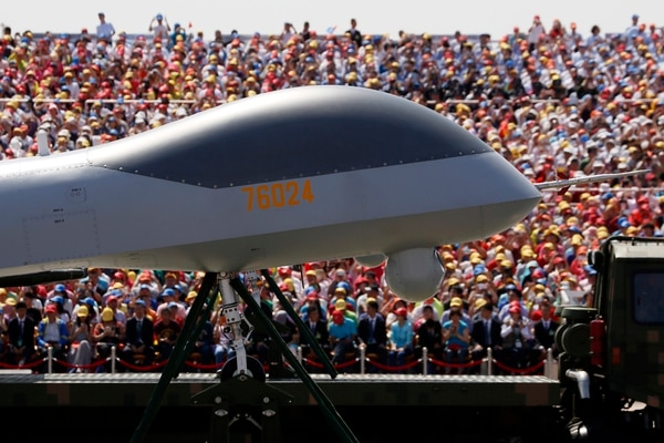FILE - In this file photo taken Thursday, Sept. 3, 2015, the front of the Wing Loong, a Chinese made medium-altitude long-endurance unmanned aerial vehicle, moves past spectators during a parade commemorating the 70th anniversary of Japan's surrender during World War II held in Beijing. Double digit annual percentage increases in China's defense budget have been fueling a top-to-bottom modernization drive that has brought in new equipment and vast improvements in living conditions for the People's Liberation Army's 2.3 million members. (AP Photo/Ng Han Guan, File)