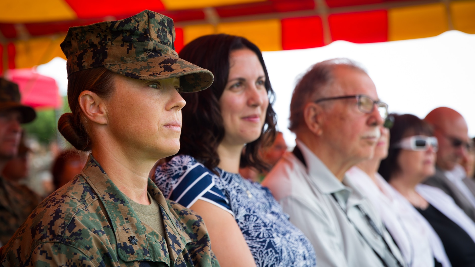 U.S. Marine Corps Lt. Col. Michelle I. Macander, then-commanding officer of 1st Combat Engineer Battalion, 1st Marine Division, sits with her family during a change of command ceremony in 2018. (Lance Cpl. Audrey C. M. Rampton/Marine Corps)