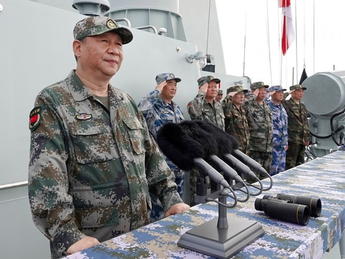 "In this April 12, 2018 photo, Chinese President Xi Jinping speaks after reviewing the Chinese People's Liberation Army Navy fleet in the South China Sea. Xi is calling on the PLAN to better prepare for combat, amid tensions over Taiwan and the South China Sea. Xi told a meeting of top military leaders Saturday, Jan. 5, 2019, that the 3-million-strong PLA needs to prepare for a ""comprehensive military struggle from a new starting point,"" according to state media reports. (Li Gang/Xinhua via AP)"