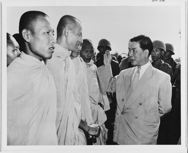 While leading the newly formed South Vietnam government, Ngo Dinh Diem is shown talking with Buddhist priests in 1955. (U.S.Information Agency)
