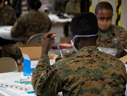 U.S. service members receive the COVID-19 vaccine aboard Marine Corps Air Station Miramar on Jan 29, 2021. (Cpl. Leilani Cervantes/Marine Corps)
