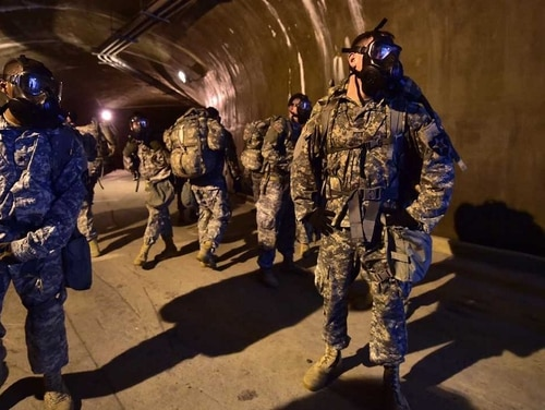 Soldiers wearing gas masks stand in a tunnel during a competition to test individual skills at Uijeongbu, South Korea. (Jung Yeon-Je/AFP/Getty Images)