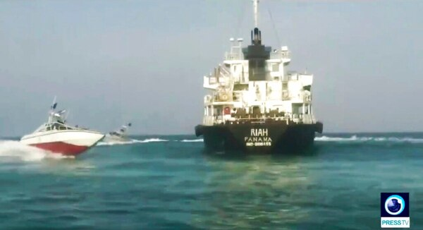 The Panamanian-flagged oil tanker MT Riah surrounded by Iranian Revolutionary Guard vessels. Iran said Thursday that its Revolutionary Guard seized a foreign oil tanker and its crew of 12 for smuggling fuel out of the country. (Press TV via AP)