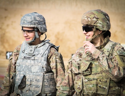 Two female U.S. soldiers walk back after checking their targets at a qualification range on Kandahar Airfield, Afghanistan, March 9, 2014. (Cpl. Clay Beyersdorfer/Army)