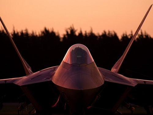 An Air Force F-22 Raptor sits on the flightline at Yokota Air Base, Japan. The GAO recommends organizing Raptors into larger squadrons. (Yasuo Osakabe/Air Force)