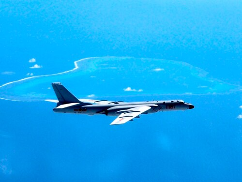 In this undated file photo released by Xinhua News Agency, a Chinese H-6K bomber patrols the islands and reefs in the South China Sea. The China Daily newspaper reported Saturday, May 19, 2018, that People's Liberation Army Air Force conducted takeoff and landing training with the H-6K bomber in the South China Sea. (Liu Rui/Xinhua via AP)