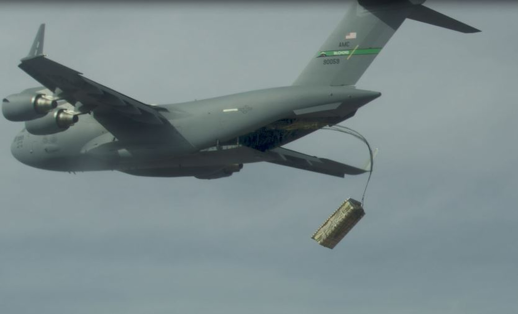 A high-altitude airdrop of palletized munitions (JASSM simulants) from a C-17 using standard operational airdrop procedures was conducted during the U.S. Air Force's testing of Advanced Battle Management System technology. (U.S. Air Force)