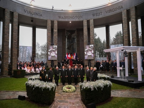 U.S. Secretary of Defence Mark Esper, second left, German President Frank-Walter Steinmeier, third left, Luxembourg's Grand Duke Henri, fourth left, Belgium's King Philippe, fifth left, Poland's President Andrej Duda, sixth left, European Council President Charles Michel, fourth right, and other authorities stand up during a minute of silence during a ceremony to commemorate the 75th anniversary of the Battle of the Bulge at the Mardasson Memorial in Bastogne, Belgium on Monday, Dec. 16, 2019. (Francisco Seco/AP)