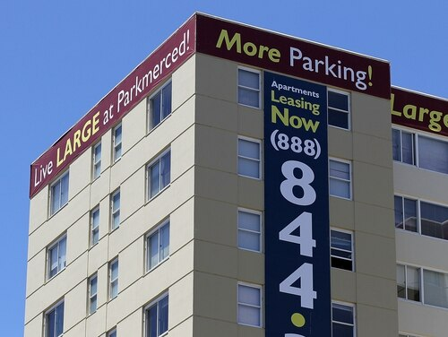 SAN FRANCISCO - MAY 26: A lease sign is posted on one of the towers at the Parkmerced apartment complex May 26, 2010 in San Francisco, California. Stellar Management-owned Parkmerced, one of the largest apartment complexes in the country, is facing default, with $500 million in loans due in October. The 116-acre complex has 1,683 rental units contained in 11 residential towers and 1,538 two-story garden townhouses. (Photo by Justin Sullivan/Getty Images)