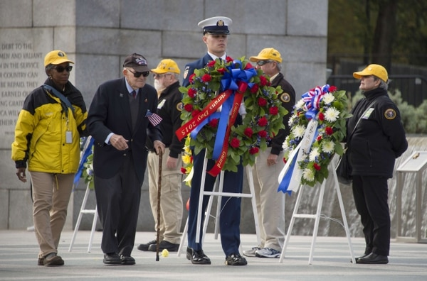 WWII Veterans place wreaths at the World War II Memorial on Veteran's Day in Washington, DC, November 11, 2015. AFP PHOTO / JIM WATSONJIM WATSON/AFP/Getty Images
