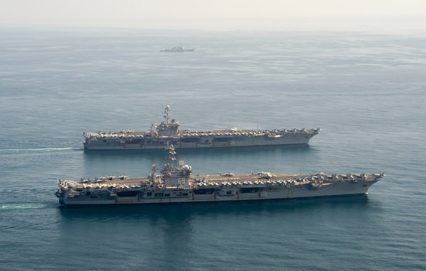 The carriers Dwight D. Eisenhower and Harry S. Truman in the Arabian Sea March 18. (Photo: Navy)