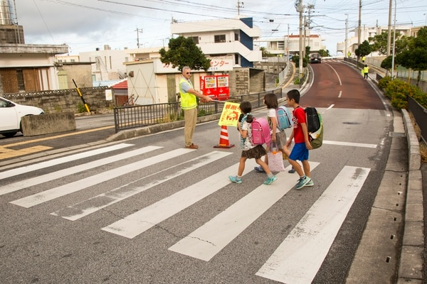 Children on their way to Kitatama Elementary School in Okinawa's Chatan, a town with about 29,000 residents. U.S. military bases sprawl over more than half of the municipality's area. (Marine Corps)