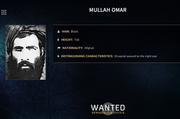 In this image released by the FBI, Mullah Omar is seen in a wanted poster. The reclusive Afghan Taliban leader has backed peace talks with the Kabul government, saying in a rare message distributed to media Wednesday, July 15, 2015 that the goal of these efforts is an