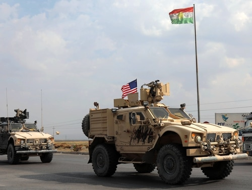 A convoy of U.S. military vehicles arrives near the Iraqi Kurdish town of Bardarash in the Dohuk governorate after withdrawing from northern Syria on Oct. 21, 2019. (Safin Hamed/AFP via Getty Images)