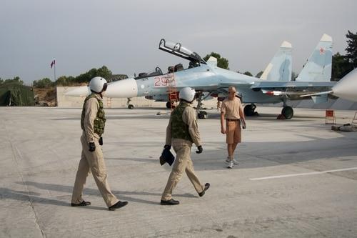 Russian pilots walk to their Su-30 jet at Hemeimeem airbase, Syria, on Oct. 22, 2015. (AP Photo/Vladimir Isachenkov)
