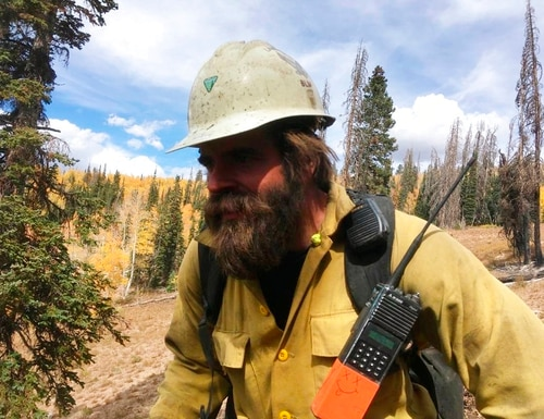 Christopher Schott works in Utah with a firefighting crew out of Lakeview, Ore. After being in firefights in Afghanistan and Iraq, members of the new elite crew from Lakeview are bringing their military experience to bear as they battle wildfires in the most rugged country back home. The Lakeview Crew 7 is comprised almost entirely of U.S. military veterans like Schott. (Courtesy of Christopher Schott via AP)