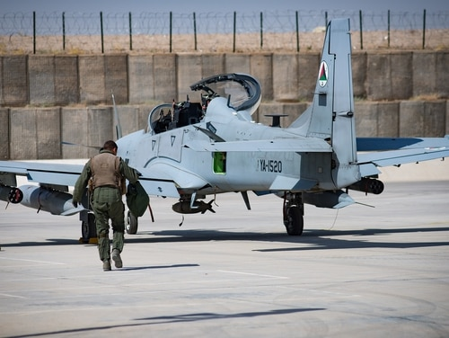 An Afghan A-29 pilot walks toward his aircraft on the flight line Sept. 10 at Kandahar Airfield, Afghanistan. The Afghan Air Force now plans and conducts all A-29 combat missions throughout Afghanistan. (Staff Sgt. Alexander Riedel/ Air Force)