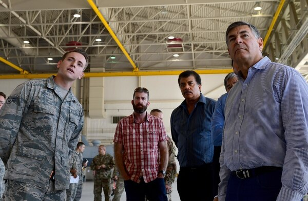 Mike Brown, right, stands with members of the Defense Innovation Board and Defense Digital Services during a brief from an airman at an MQ-9 Reaper display at Creech Air Force Base, Nev., on Sept. 12, 2019. (Senior Airman Haley Stevens/U.S. Air Force)