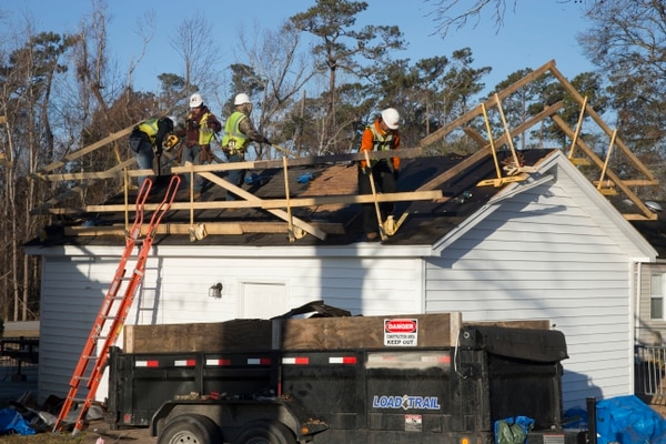 Repairmen remove shingles damaged by Hurricane Florence from a home in Paradise Point housing on Marine Corps Base Camp Lejeune, N.C., in February. (Lance Cpl. Ginnie Lee/Marine Corps)