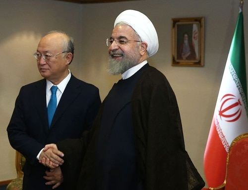 A handout picture released on July 2, 2015 by the official website of the Iranian President Hassan Rouhani shows him (R) meeting with the head of the UN's atomic watchdog Yukiya Amano during a meeting in the capital Tehran. Amano will have a series of meetings with Iranian officials to try to advance the negotiations over Tehran's nuclear program, which are the subject of intense negotiations in Vienna between Iran and the so-called P5+1 group (China, USA, France, UK, Russia and Germany). AFP PHOTO / HO / IRANIAN PRESIDENCY WEBSITE== RESTRICTED TO EDITORIAL USE - MANDATORY CREDIT