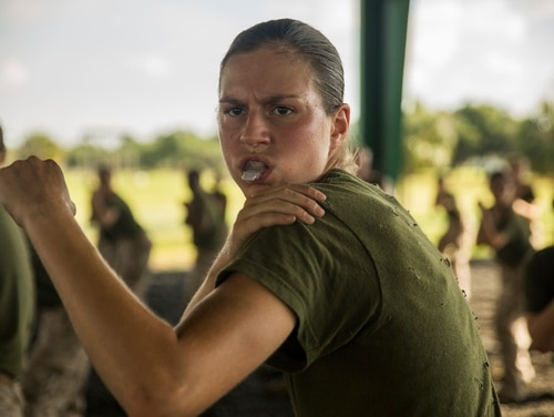 Recruit Anna J. Hereth, Platoon 4026, November Company, 4th Recruit Training Battalion, practices a falling during a martial arts training session in May 2015 at Parris Island, South Carolina. (Sgt. Jennifer Schubert/Marine Corps)