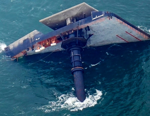 The capsized lift boat Seacor Power is seen seven miles off the coast of Louisiana in the Gulf of Mexico Sunday, April 18, 2021. The vessel capsized during a storm on Tuesday. (Gerald Herbert/AP)