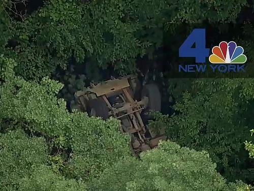 In this photo taken from video provided by NBC New York, a light medium tactical vehicle sits overturned near the Camp Natural Bridge summer military training camp off Route 293, Thursday, June 6, 2019 in Cornwall, N.Y. West Point officials say one cadet was killed and over a dozen people were injured when the vehicle they were riding in for summer training overturned. (NBC New York via AP)