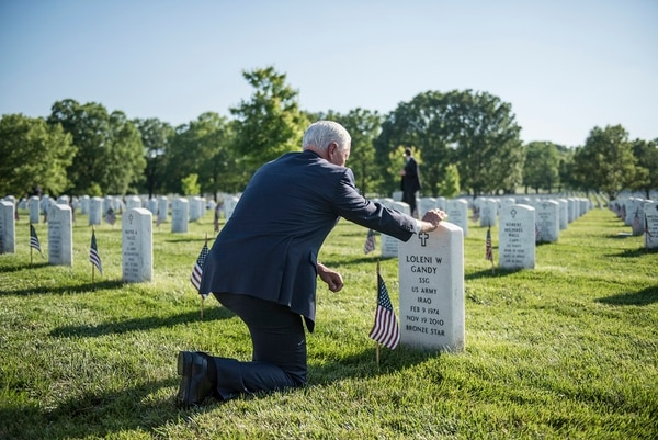 Vice President Mike Pence places a flag at a gravesite in Section 60 during Flags In at Arlington National Cemetery, Arlington, Virginia, May 24, 2018. Pence also visited with Arlington National Cemetery and Old Guard leadership. (Elizabeth Fraser/Arlington National Cemetery)